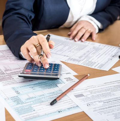 image shows person calculating tax returns